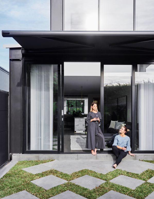 Backyard looking in to lounge through large sliding doors