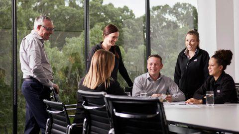 A&L Windows team members around table